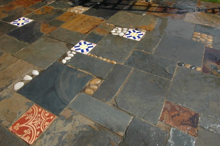 Consider adding old tiles or pebbles for interest