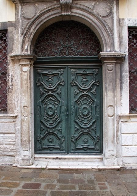 An ornate carved double door in Venice
