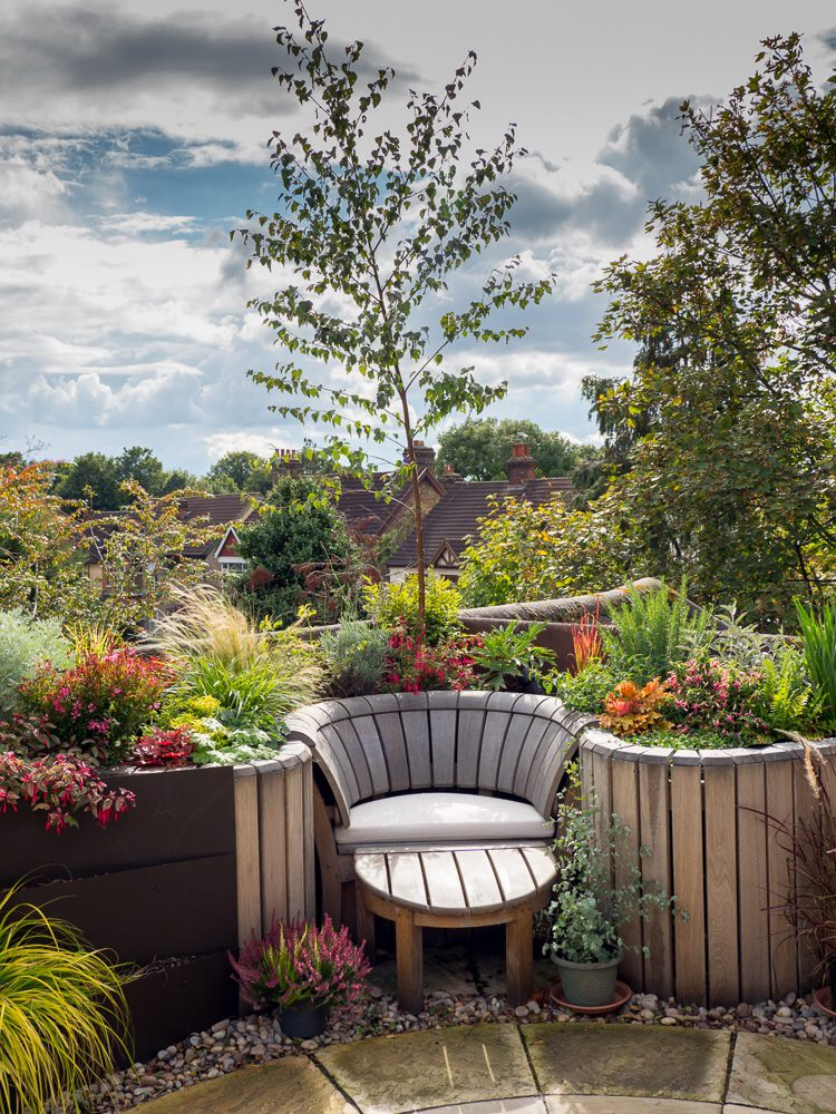 small garden design ideas - use built-in furniture to conserve space