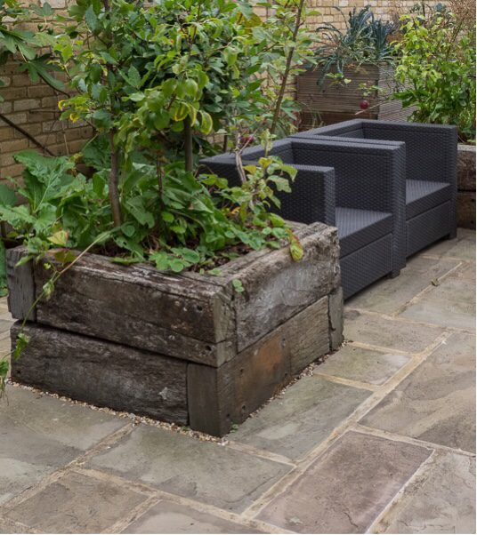 Railway slepper beds are great for garden layout design