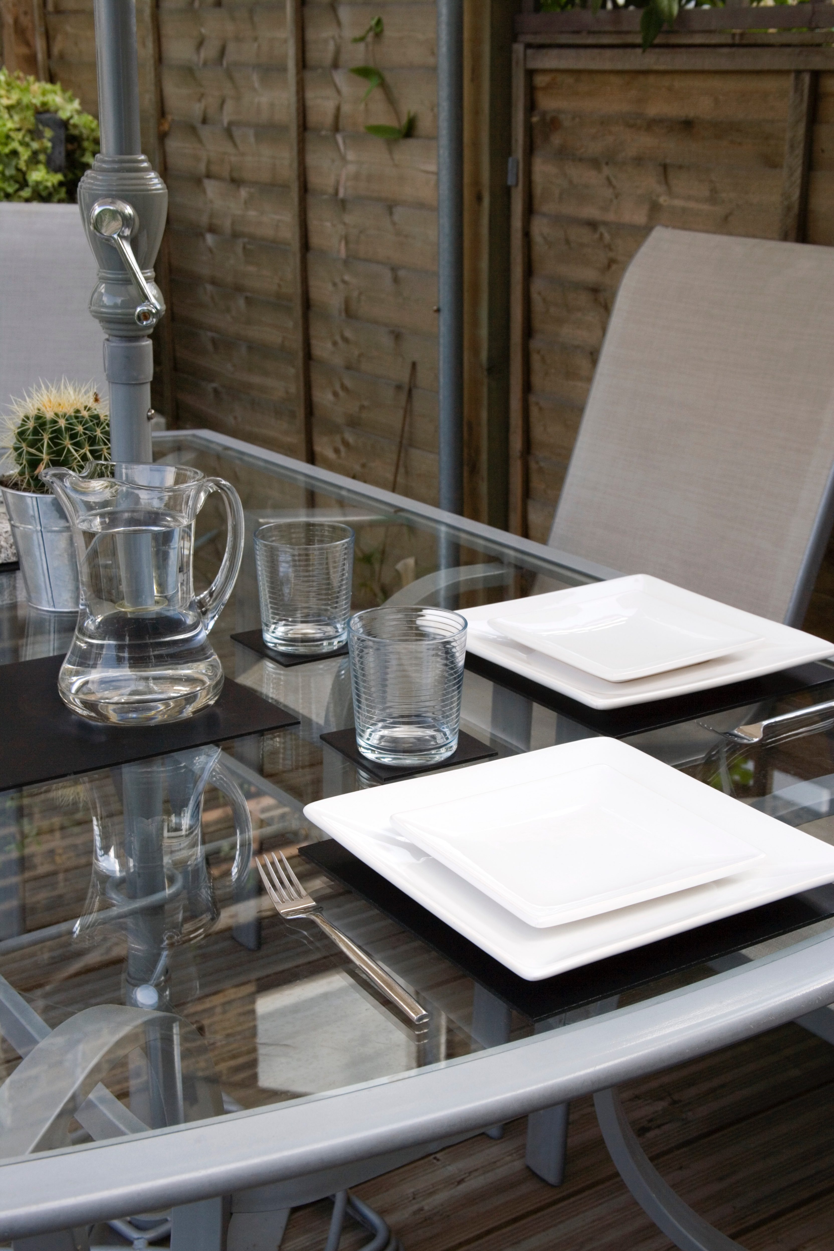 Lay your patio table as you would your dining table - garden patio design
