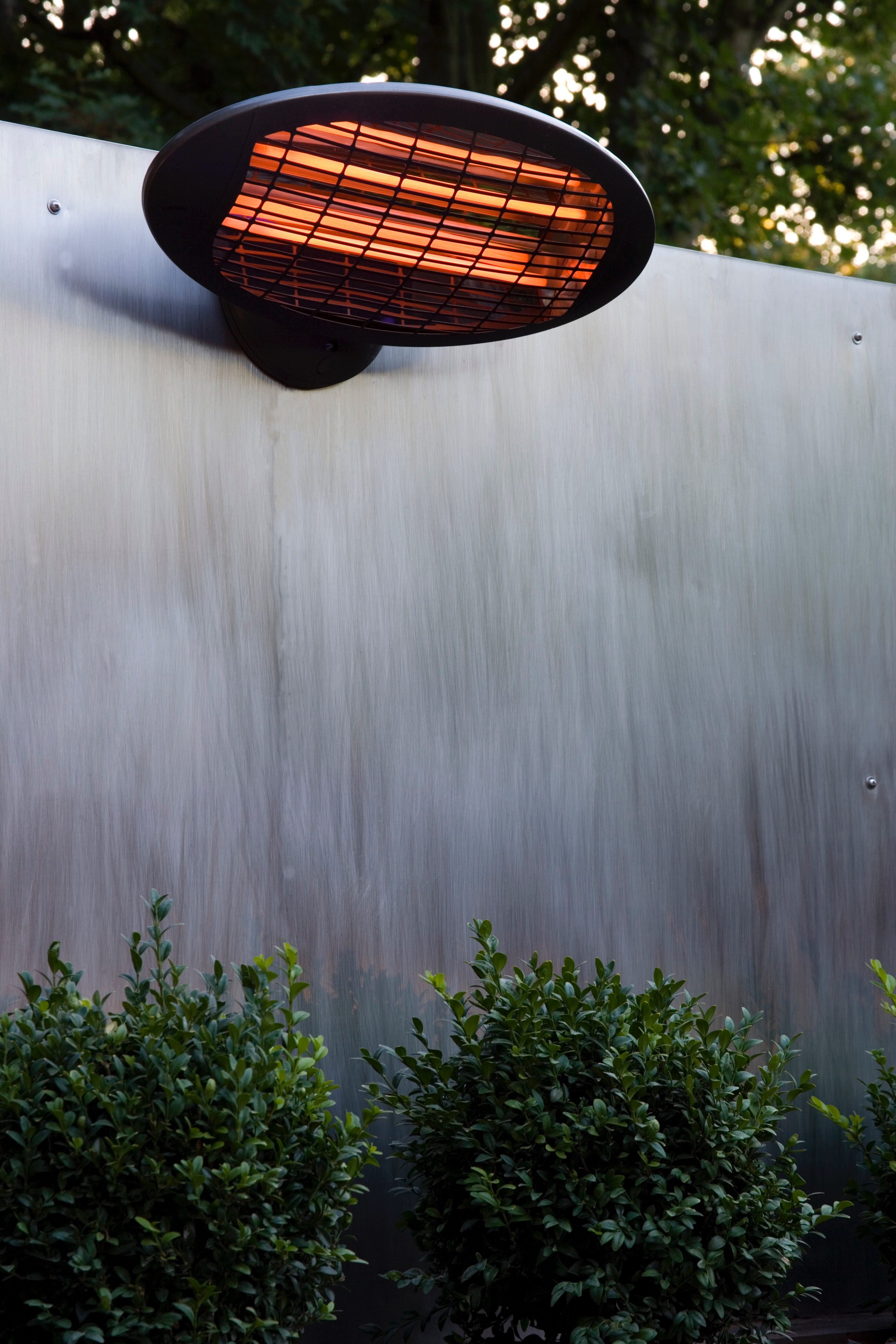 Add lights and heat to enhance your garden patio design