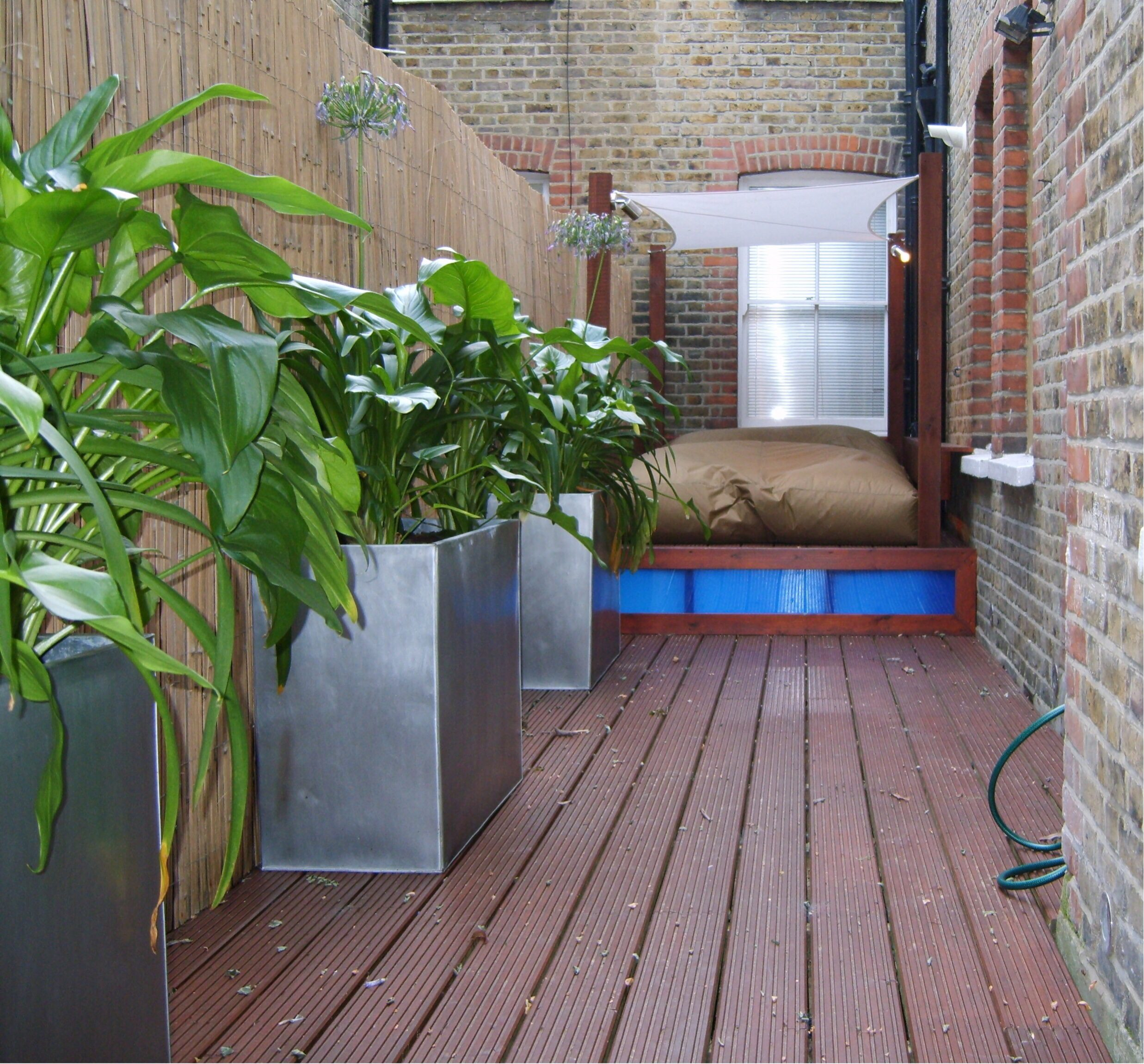 Shade sails are popular in private garden design
