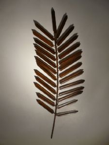 Lush foliage planting may be complimented with this wall art leaf