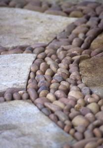 Detail of decorative pebbles set into paving