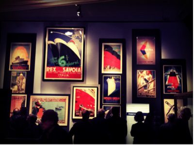 A whole wall of posters, all using a similar colour palette