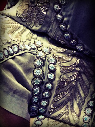 Intricate detailing here in the oriental inspired flapper dress