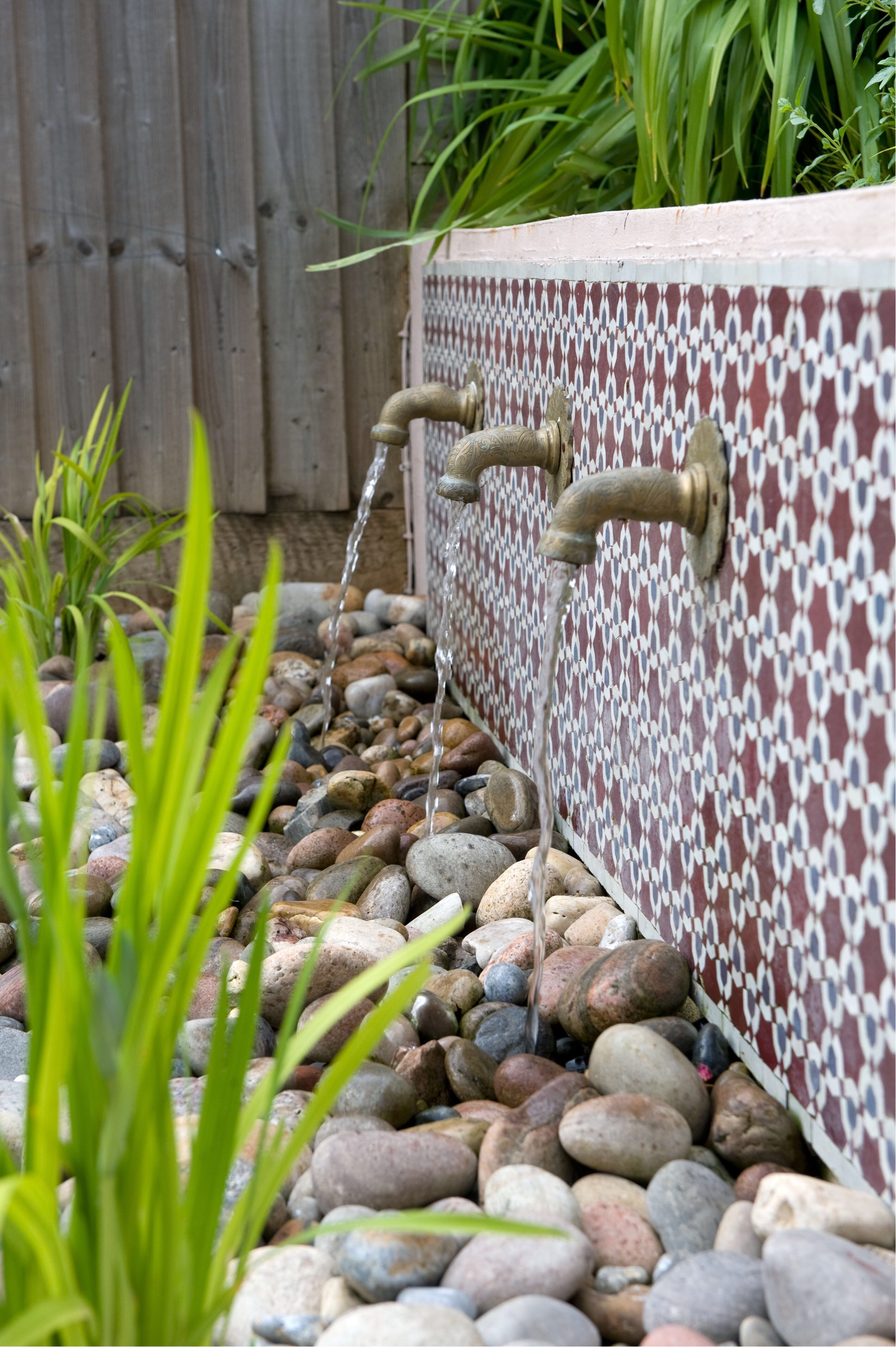 Garden water feature design tips - wall mounted ones are popular